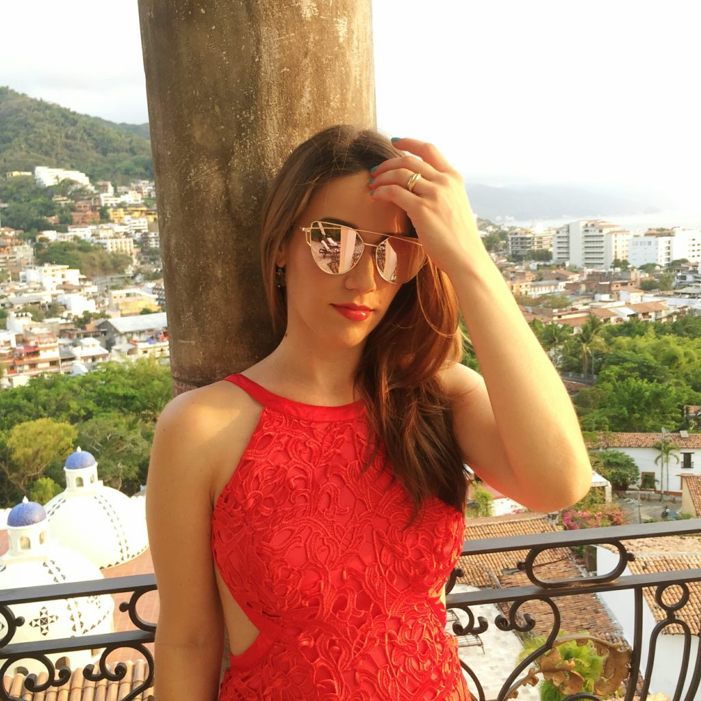 chic woman in red dress and sunglasses