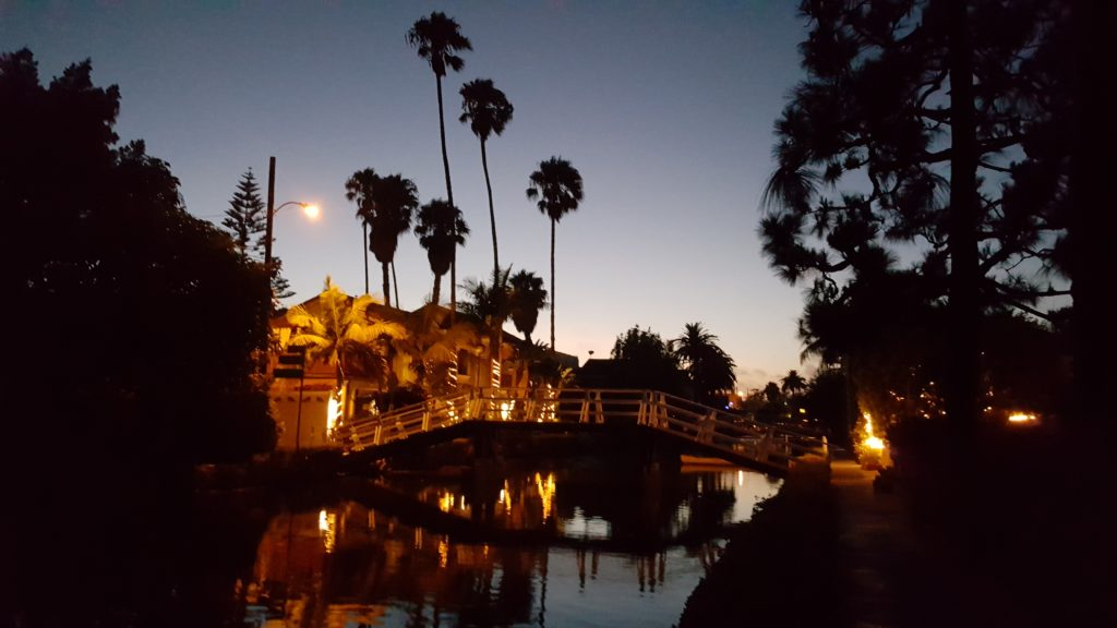 watch the sun set at the venice beach canals